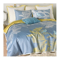 Blissliving Home - Icelandic Dream Duvet Collection - Our Icelandic Dream cotton sateen duvet set finds its inspiration in Iceland's spare, Pristine landscapes as well as its modern design influence. Etched motifs of blue birds resting on branches seem to float above a mosaic pattern in tone-on-tone slate blue. Features: -Available in Twin, Full / Queen or King sizes. -Includes comforter cover and matching sham. -Material: 100% Cotton. -300 Thread count. -Button duvet, envelope sham. -Duvet is accented with, and reverses to, hemp yellow. -Matching shams are designed form a continuous design when placed side-by-side. -Complete set is finished with a tailored flange in cream. -Machine washable. -Window panels have pole pocket top and pieced solid panel at the lower hem. -Shower curtain also available.