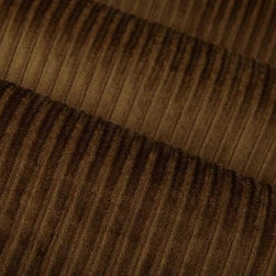 Viva Upholstery Fabric in Pecan - Viva in Coffee is a tan velvet upholstery fabric with channeled stripes. This fabric is incredibly durable and has a soft texture that's ideal for reupholstering furniture, or for creating bedding and pillows. Available in current colors, this velvet plush has a feel that's irresistible. Made from 100% Polyester. Fire Rating UFAC Class 1. Cal Tech Bulletin #117, SEC.E. 100,000 double rubs. 54″ wide.