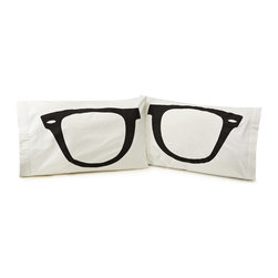 Inova Team -Modern 100% Cotton Pillowcase - Set of 2 - Just rest your eyes on this tirelessly hip set of pillowcases. The pop art silhouette of black plastic glasses is spread across the face of both pillows, artfully framing your bed. The image is printed on 100% cotton fabric, which will feel cool and beautiful even when your eyes are closed. Pillow inserts not included.