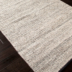 Hideaway Soft Gray Flat Weave Rug - Ripples of undyed wool twisted with neutral recycled sari silk create an unusual pattern in the tight, dense texture of the Hideaway Soft Gray Flat Weave Rug � a pattern perfect for pairing with dressmaker details on furniture or with sleek, updated accents.  Pair this transitional rug with black and white furniture for a poised, coordinated appearance or provide a patterned rest for the eye in a colorful room.