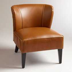 World Market - Caramel Quincy Leather Chair - Our cosmopolitan Caramel Quincy Leather Chair impresses in any setting with its bonded leather upholstery and deep-seated, gently wing-backed design. Espresso-toned birch legs and chic nail head detail finish the look of this fetching find, effortlessly elevating a living room, bedroom or library.