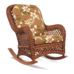 WickerParadise - Brown Wicker Rocker - Lanai - One word comes to mind when you first see this brown wicker rocker — vacation. You can almost feel the ocean breeze as you gently rock back and forth on the tropical cushions.