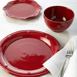 Holiday Entertaining - Rimmed in a simple thread motif and adorned with a sprinkling of berries, this classic dinnerware brings texture and warm color to table settings.