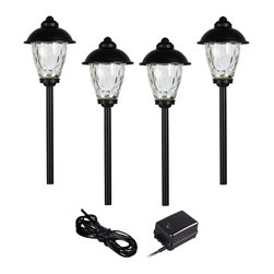 "Lamps Plus - Transitional Concord 6-Piece Bronze Complete LED Landscape Lighting Set - Give your front or backyard stylish accent lighting with this complete landscape lighting set. This kit includes four low-voltage LED path lights with white glass globes a bronze finish and aluminum construction. A 45-watt low voltage transformer is included which features a built-in photocell for dusk to dawn operation. A black landscape wire completes the kit so you can connect your lights bringing this set together for a spectacular look. Works with existing low voltage landscape lighting systems.  Bronze 6-piece set.  4 LED path lights one 45-watt low voltage transformer cable.  Path lights include a 1.5 watt LED.  Comparable to a 10 watt incandescent bulb.  45 watt transformer.  Built-in photo-cell for dusk to dawn operation.  Full ON mode or three AUTO settings (4 6 and 8 hours).  100 feet of cable.  Ground stakes included.  7"" high path light lanterns."