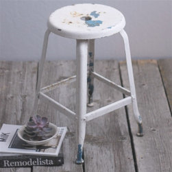 Cast Metal Stool - This amazing farm stool is perfection. I love the chippy iron-look finish, which would be perfect around a kitchen island.