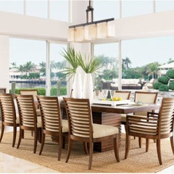 Tommy Bahama by Lexington Home Brands Ocean Club 11 Piece Penninsula Dining Set - The Tommy Bahama Home Ocean Club 11 pc. Penninsula Dining Set with Kowloon Chairs offers a unique look of tropical urban chic. The double pedestal base is made of select hardwoods with hickory veneers and bali brown finish. Each pedestal base is designed with horizontal grooves for a stacked wood look. This set includes table with 8 side chairs and 2 arm chairs. Upholstered chairs with tapered legs and woen taupe and cream fabric. Table dimensions: 78-100L x 44W x 30H inches. Chair dimensions: 22.25W x 24.5D x 36H inches. Seat height 19 inches. About Tommy Bahama Home Tommy Bahama started as an upscale men's casual sportswear line and has transformed into a signature brand expanding their product line to accommodate women's apparel golf wear footwear home furnishings and even retail and restaurant compounds. The Tommy Bahama brand represents quality products with fashion forward designs that are available at an affordable price. Their signature island-lifestyle designs suggest a modern style with an emphasis on comfort and relaxation.