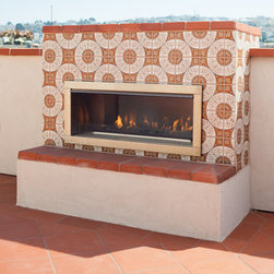 Fireclay Tile - Cuerda Seca - Our Debris Series recycled tile is an excellent choice for any fireplace surround. This client chose one of our Cuerda Seca medallions in a range of warm tones to accent this exterior fireplace.