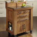 "Home Styles - Vintage Gourmet Kitchen Cart - The Vintage is the quintessential kitchen cart for the gourmet food and wine connoisseur in need of additional space. Expertly designed, the Vintage gourmet kitchen cart by Home Styles is a perfect addition to any kitchen. To complete the look the product is finished on all four sides and accessorized with shaped linear brushed antiqued nickel hardware pulls. Features: -Easy mobility for use during parties and gatherings.-Rubber wood solids and veneers.-Four large storage drawers.-Finished on all four sides and accessorized with shaped linear brushed antiqued nickel hardware pulls.-Product Type: Kitchen Cart.-Base Finish: Vintage Caramel.-Counter Finish: Granite inset.-Hardware Finish: Brushed nickel.-Distressed: Yes.-Powder Coated Finish: No.-Gloss Finish: No.-Base Material: Wood.-Counter Material: Granite.-Hardware Material: Brushed antiqued nickel.-Solid Wood Construction: No.-Number of Items Included: 1.-Water Resistant or Waterproof: No.-Stain Resistant: No.-Warp Resistant: No.-Exterior Shelves: No.-Drawers Included: Yes -Number of Drawers: 4.-Push Through Drawer: No..-Cabinets Included: Yes -Number of Cabinets : 1.-Double Sided Cabinet: No.-Adjustable Interior Shelves: Yes.-Number of Doors: 2.-Locking Doors: No.-Door Handle Design: Linear pulls..-Towel Rack: No.-Pot Rack: No.-Spice Rack: No.-Cutting Board: No.-Drop Leaf: No.-Drain Groove: No.-Trash Bin Compartment: No.-Stools Included: No.-Casters: Yes -Locking Casters: Yes.-Removable Casters: No..-Wine Rack: Yes -Removable Wine Rack: No..-Stemware Rack: No.-Cart Handles: No.-Finished Back: Yes.-Commercial Use: No.-Recycled Content: No.-Eco-Friendly: No.-Product Care: Clean with a damp cloth.Specifications: -ISTA 3A Certified: Yes.Dimensions: -Overall Height - Top to Bottom: 42.5"".-Overall Width - Side to Side: 34.75"".-Overall Depth - Front to Back: 20"".-Width Without Side Attachments: 34.75"".-Countertop Thickness: 0.75"".-Countertop Width - Side to Side: 34.75"".-Countertop Depth - Front to Back: 20"".-Leaf: No.-Drawer: -Drawer Interior Height - Top to Bottom: 2.75"".-Drawer Interior Width - Side to Side (Top Drawers) : 8.5"".-Drawer Interior Width - Side to Side (Bottom Drawers) : 20.25"".-Drawer Interior Depth - Front to Back: 14.5""..-Cabinet: -Cabinet Interior Height - Top to Bottom: 13.5"".-Cabinet Interior Width - Side to Side: 19.5"".-Cabinet Interior Depth - Front to Back: 15.75""..-Overall Product Weight: 92.60 lbs.Assembly: -Assembly Required: Yes.-Tools Needed: Phillips screwdriver.-Additional Parts Required: No.Warranty: -Product Warranty: Vendor replaces parts for 30 days."