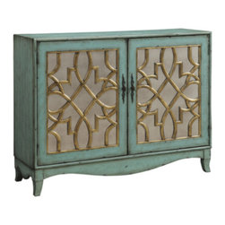 Coast To Coast - Coast To Coast - Two Door Cabinet In Hugh Soft Seafoam With Gold - 61615 - Classic lines, artistic designs and a soothing color all combine into one unforgettable cabinet. Finished in an aged Hugh Soft Seafoam tone, the main attraction are the two doors with their Gold accented graphic pattern over mirrored insets, and decorative metal pulls. Inside two shelves add more storage options.