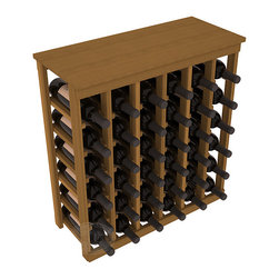 36 Bottle Kitchen Wine Rack in Redwood with Oak Stain - A small wine rack with big storage. This wine rack kit is the best choice for converting tiny spaces into big wine storage. The solid wood top excels as a table for wine accessories, small plants, and wine collectables. Store 3 cases of wine properly in a space smaller than most entry tables!