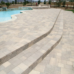 Bella Vista Stonetop Interlocking Pavers - The Bella Vista Stonetop concrete interlocking pavers have a cleft surface which gives the textured appearance of natural stone. Available in an array of beautiful colors, our 3-piece paver system provides the flexibility to give you the capability to design your own unique paver area.