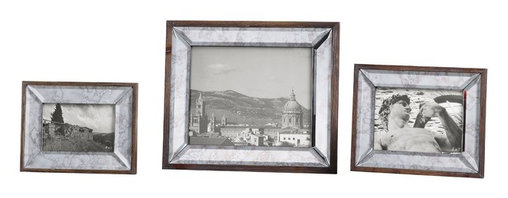 "Uttermost - Uttermost Daria Antique Mirror Photo Frames Set of 3 18567 - Display those special photos in these sophisticated frames made of antiqued, beveled mirrors accented with an aged pecan stained solid wood outer frame. Holds photo sizes 4""W x 6""H, 5""W x 7""H, 8""W x 10""H. Frame sizes: Small 6""W x 8""H x 1""D, Medium 8""W x 10""H x 1""D, large 12""W x 14""H x 1""D."