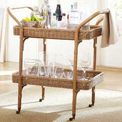 """Jacquelyne Rattan Wicker Bar Cart - Handcrafted from natural rattan, this cart reveals the rich color and texture of the woven fiber. It rolls on casters, so it's easy to move to wherever guests are gathered. 31"""" wide x 19"""" deep x 34"""" high Features two shelves for holding spirits. Wicker is expertly handwoven. Finished by hand in Wheat/Rye and sealed for a lasting natural appearance. View our {{link path='pages/popups/fb-dining.html' class='popup' width='480' height='300'}}Furniture Brochure{{/link}}."""