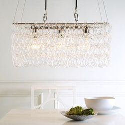 Glass Link Chandelier - A chic, modern take on traditional design. Inspired by mid-century Venetian chain glass chandeliers, cascades of tempered glass refract the light and add festive sparkle to the table.