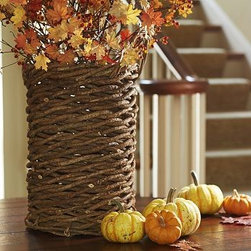 """Mila Woven Vine Basket Vase - Our handwoven textural Mila basket lives a double life. Use it as a natural vessel for dried botanicals or as a stylish umbrella stand. 12.25"""" diameter, 23"""" high Made of handwoven natural white vine."""