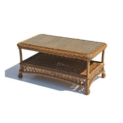 Wicker Paradise - Outdoor Wicker Coffee Table - Montauk Shown in Natural - The Montauk coffee tables is woven vinyl on an aluminum frame and features inset glass top with an additional shelf for storage. I love the coffee table in front of a sofa or loveseat. It completes the look to a room and you also can have your snacks and beverages handy for your friends and family to enjoy as you sit outdoors.