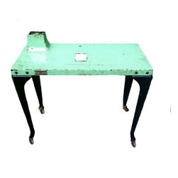 """Industrial - Teal and black industrial factory table from Westinghouse circa 1950's. This incredible piece will transform your living or work space in a way that words cannot describe. This piece of authentic Americana industrial chic rolls on castors and once included a built-in lamp. The lamp switch remains. Metal tags with Westinghouse logo. 25"""" tall (30"""" including the raised lamp setting). 30"""" wide x 14"""" deep. Conversation starter if ever there was one."""