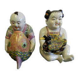 "Porcelain Asian Statues - A Pair - This unique vintage duo is from an estate in Pam Beach Florida. There's a boy riding a fish and a girl holding a duck. Grab your favorite animal and join in the fun! Both are in great condition. The smaller of the two measures 9.5""W x 10""D x 14""H. The dimensions below are for the larger of the two."