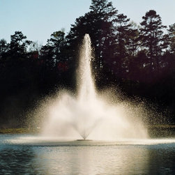 Kasco Marine - 5.1 J Series Decorative Outdoor Fountain - 5.1JF100 - Shop for Fountains from Hayneedle.com! Designed for larger ponds the 5.1 J Series Decorative Fountain offers efficient aeration and six dramatic spray patterns. This floating fountain aerator comes with five interchangeable nozzles providing you with the versatility of six different patterns for displays of up to 26 feet in height or 50 feet in diameter. The spray patterns include three geysers a two-tier and two V-shaped funnel patterns. You have the freedom to adjust the nozzles at any time to fit specific pond dimensions wind conditions and your personal preference. (Not pictured: no-nozzle configuration.)In addition to its stunning aesthetic qualities this fountain agitates and spreads oxygenated water throughout your pond or lake. This process discourages algae growth and helps maintain a healthy aquatic environment. The fountain operates successfully at a minimum water depth of 26 inches.The 5.1J Series Fountain has an extremely efficient 240 volt 60 Hz motor. This eco-friendly motor is made of rugged stainless steel and is silicone-sealed against leaks. The fountain is supplied with a state-of-the-art GFCB-protected control panel model C-95. The C-95 control panel features GFCB protection a 24-hour timer surge protection and 120-volt GFI-protected lighting outlet in a rain-proof enclosure. A photoelectric unit-synchronized circuit controls the 120-volt lighting outlet for lights (light kit not included). The GFCB 30-amp circuit is designed to protect you and your equipment. Kasco recommends a licensed electrician to install the C-95 control panel and the 5.1J fountain if you plan to hard-wire the unit into the C-95 control panel.Features and Benefits of the 5.1 J Series Fountain:Motor: 5HP 1750 RPM 240-volt single phase 60 Hz oil-cooled continuous duty-rated and submersible.Multiple Spray Patterns in One Unit: Custom-configure the unit to your exact needs and preferences. Includes 5 nozzles 