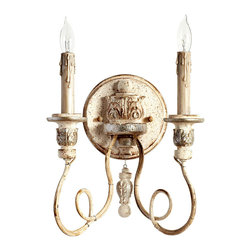 Florine Two Light Wall Bracket - Looping arms support richly-appointed candles on a dramatic circular plaque in the Florine Two Light Wall Bracket, a grand and aristocratic wall light for wide hallways and lavish bedrooms. Finished in a wonderfully distressed mix of antique silver and Persian white, this sconce has a hint of tarnish that contributes to its sense of palatial provenance.