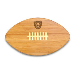 """Picnic Time - Oakland Raiders Touchdown Pro Cutting Board in Natural Wood - The Touchdown! cutting board is a 15"""" x 8.75"""" x 0.75"""" board made of eco-friendly bamboo with a standard football design, with 123 square inches of cutting surface. It can be used as a cutting board or serving tray, or use both sides of the board, one for cutting and the other for serving. The backside of the board is solid dark bamboo. Go long...for the Touchdown! Decoration: Engraved"""