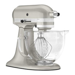 KitchenAid KSM155GBSR Artisan Design Series Stand Mixer with Glass Bowl - Sugar - Complete any kitchen mixing task with ease with the KitchenAid KSM155GBSR Artisan Design Series Stand Mixer with Glass Bowl - Sugar Pearl Silver. From its durable all-metal construction to its generous 5-quart glass bowl and handy accessories this mixer is designed to help you get the job done. Additional Features: 14.13L x 8.75W x 14H inches Tilt head for easy bowl access Powerful direct-drive transmission Power hub to add attachments Planetary mixing action About KitchenAidFor over 80 years KitchenAid has been devoted to creating innovative cookware that inspires culinary excellence. From the original Stand Mixer first created in Troy Ohio this industry leader now offers a wide assortment of cookware bakeware kitchen accessories and appliances. All products are designed with your cooking needs in mind and are engineered to exceed the highest manufacturing standards. Since 1919 KitchenAid has been synonymous with quality and value. As a result all KitchenAid products are backed by exceptional industry-leading warranties. Check out the complete line today.