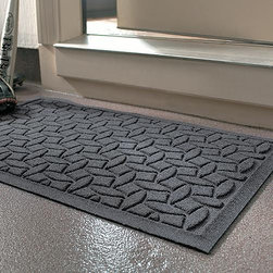 Frontgate - WATER & DIRT SHIELD ™ Ellipse Commercial Grade Door Mat - Crafted of commercial-quality polypropylene. Rubber-reinforced nubs prevent the pile from crushing. Entrymat dries quickly; will not fade or rot. Dam-like design traps water and dirt, preventing hazards and floor damage near the mat. Rubber backing to prevent slippage. Provide your entryways with superior protection, using our WATER & DIRT SHIELD ™ Ellipse Commercial Grade Door Mat. Built to withstand more than the normal range of dirt, water and mud generated around a typical home, this highly durable door mat mat will serve your needs for years to come, while adding a decorative element to your home's exterior.. . . . . Suitable for all floor types. Note: Do not place on wet floors. Great for mudrooms, entryways, workshops and garages.