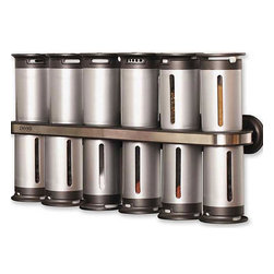 Wall-Mount Spice Rack, 12 Canisters (Zevro) - The space-efficient Zero Gravity Magnetic Wall-Mount Spice Rack lives up to its name, as the 12 spice canisters can be placed on or hung below the included stainless steel accented shelf or any other metallic surface. Each canister includes a rubber foot which prevents scratching and also allows the canister to be placed on vertical surfaces. With a flip of the finger, the patent-pending pour control system adjusts between closed, sprinkle and pour, allowing for easy, one-handed use of the canisters. The canisters are designed to keep the spices fresh, and each includes a viewing window to identify the spices within.