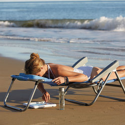 "Frontgate - Breezy Beach Sun Lounger - Cooling mesh resists the effects of sun, salt water, mold, and mildew. Removable ottoman and lumbar pillow offer customized head-to-toe support. Lightweight, powdercoated aluminum frame folds compactly and includes a carry strap. For easy transport and storage, simply detach the ottoman, place it on the seat of the chair, fold the chair, then use the integrated buckles on the seat and headrest to secure it all together. When the lounger is fully extended, the foot side is 12""H and the head side is 13.4""H. Our exclusive Breezy Beach Sun Lounger keeps you cool and comfortable. The seating surface is made of breathable and quick-drying duramesh that allows air to circulate freely. The chair fully adjusts to five positions, including comfortably on your stomach, so you can sit upright, recline, or turn over. See the Frontgate Difference.  .  .  . . . Coordinates with the Breezy Beach Collection . Clean with mild soap and water . Imported."