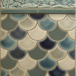 Traditional with a Twist - Small scallop/scale shaped tile create the feeling of an undersea wonderland when used to tile an entire shower or bathroom.
