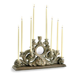 European Candleholder - Effusive in detail but slightly severe, the European Candleholder captures the solid, elegant presence of a family heirloom, its old-world appeal legitimized by an ash-hued wash that finishes each carven curve in a matte grey. The ideal companion to architectural fragments or finials, this piece has a limited horizontal footprint suiting narrow shelves.