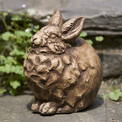Campania International - Campania International Snowball The Sittin Bunny Cast Stone Garden Statue - A-35 - Shop for Statues and Sculptures from Hayneedle.com! About Campania InternationalEstablished in 1984 Campania International's reputation has been built on quality original products and service. Originally selling terra cotta planters Campania soon began to research and develop the design and manufacture of cast stone garden planters and ornaments. Campania is also an importer and wholesaler of garden products including polyethylene terra cotta glazed pottery cast iron and fiberglass planters as well as classic garden structures fountains and cast resin statuary.Campania Cast Stone: The ProcessThe creation of Campania's cast stone pieces begins and ends by hand. From the creation of an original design making of a mold pouring the cast stone application of the patina to the final packing of an order the process is both technical and artistic. As many as 30 pairs of hands are involved in the creation of each Campania piece in a labor intensive 15 step process.The process begins either with the creation of an original copyrighted design by Campania's artisans or an antique original. Antique originals will often require some restoration work which is also done in-house by expert craftsmen. Campania's mold making department will then begin a multi-step process to create a production mold which will properly replicate the detail and texture of the original piece. Depending on its size and complexity a mold can take as long as three months to complete. Campania creates in excess of 700 molds per year.After a mold is completed it is moved to the production area where a team individually hand pours the liquid cast stone mixture into the mold and employs special techniques to remove air bubbles. Campania carefully monitors the PSI of every piece. PSI (pounds per square inch) measures the strength of every piece to ensure durability. The PSI of Campania pieces is currently