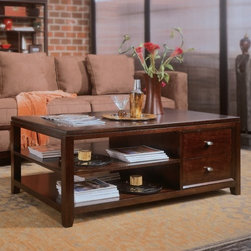 "American Drew Tribecca Rectangular Coffee Table - For a coffee table that looks as good as sarsaparilla tastes, go with the American Drew Tribecca Rectangular Coffee Table. Yes, it's got a root beer finish, durable construction, and plenty of storage. Quench your coffee table thirst, pardner.About American DrewFounded in 1927, American Drew is a well-established, leading manufacturer of medium- to upper-medium-priced bedroom, dining room, and occasional furniture. American Drew's product collections cover a broad variety of style categories including traditional, transitional, and contemporary. Their collections range from the legendary 18th-century traditional """"Cherry Grove,"""" celebrating its 42nd year of success, to the extremely popular """"Bob Mackie Home Collection,"""" influenced by the world-renowned fashion designer Bob Mackie. """"Jessica McClintock Home"""" features another beloved designer bringing unique style to an American Drew line. American Drew's headquarters are located in Greensboro, N.C. Their products are distributed through thousands of independently owned retailers throughout the United States and Canada and around the world."