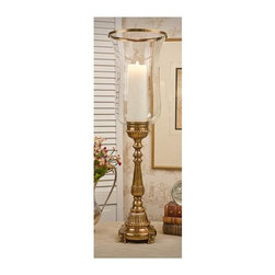 "Dessau Home - Footed Hurricane Candle Holder - Made from brass. Antique brass color. Made in India. Glass top: 8.5 in. Dia.. Base: 7 in. Dia.. Overall: 30 in. HValue has always been an essential ingredient at Dessau Home. ""Essentials"" represents a collection of well-appointed yet affordable home furnishings with a unique traditional styling that appeals to most transitional and contemporary home decorating needs."