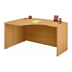 Bush Business - Left Corner L Desk in Light Oak - Series C - The Light Oak Series C Left Corner L Desk usefully fills that difficult corner and allows users to face the approach side while keyboarding.  This attractive desk accepts a universal or articulating keyboard shelf, and accepts a left return as well. * Accepts Universal or Articulating Keyboard Shelf. L-Bow desk allows user to face approach side while keyboarding, and affords greater computer screen privacy. Accepts Right Return. Desktop & modesty panel grommets for wire access and concealment. Durable melamine surface resists scratches and stains. Durable PVC edge banding protects desk from bumps and collisions. 58.858 in. W x 42.874 in. D x 29.842 in. H