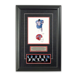 """Heritage Sports Art - Original art of the NFL 1991 Buffalo Bills uniform - This beautifully framed piece features an original piece of watercolor artwork glass-framed in an attractive two inch wide black resin frame with a double mat. The outer dimensions of the framed piece are approximately 17"""" wide x 24.5"""" high, although the exact size will vary according to the size of the original piece of art. At the core of the framed piece is the actual piece of original artwork as painted by the artist on textured 100% rag, water-marked watercolor paper. In many cases the original artwork has handwritten notes in pencil from the artist. Simply put, this is beautiful, one-of-a-kind artwork. The outer mat is a rich textured black acid-free mat with a decorative inset white v-groove, while the inner mat is a complimentary colored acid-free mat reflecting one of the team's primary colors. The image of this framed piece shows the mat color that we use (Red). Beneath the artwork is a silver plate with black text describing the original artwork. The text for this piece will read: This original, one-of-a-kind watercolor painting of the 1991 Buffalo Bills uniform is the original artwork that was used in the creation of this Buffalo Bills uniform evolution print and tens of thousands of other Buffalo Bills products that have been sold across North America. This original piece of art was painted by artist Tino Paolini for Maple Leaf Productions Ltd. Beneath the silver plate is a 3"""" x 9"""" reproduction of a well known, best-selling print that celebrates the history of the team. The print beautifully illustrates the chronological evolution of the team's uniform and shows you how the original art was used in the creation of this print. If you look closely, you will see that the print features the actual artwork being offered for sale. The piece is framed with an extremely high quality framing glass. We have used this glass style for many years with excellent results. We package every piece"""