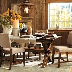 "Toscana Rectangular Extending Dining Table & everydaysuede(TM) Manchester Chair - Our Toscana Dining Table evokes a 19th-century Northern Italian tailor's table with its X-shaped supports, keyed-through tenons and warm Tuscan Chestnut finish. Ideal for large gatherings, the set is paired with our Manchester chairs, designed with a gently pitched back and firmly cushioned for comfort. Table: 88.5"" long x 40"" wide x 30"" high Chair: 18"" wide x 23"" deep x 36.5"" high Two 18"" leaves drop in seamlessly at either end to expand its length to 124.5"", comfortably accommodating up to 10. Handcrafted with a kiln-dried wood frame. The Tuscan Chestnut Finish is a 14-step process with hand-applied layers, hand distressing and burnished edges that give the table the look of a well-loved antique. Chair is upholstered in the finest-quality top-grain leather, everydaysuede(TM) or linen. Wood swatches, below, are available for $25 each. We will provide a merchandise refund for wood swatches if they're returned within 30 days. View our {{link path='pages/popups/fb-dining.html' class='popup' width='480' height='300'}}Furniture Brochure{{/link}}."