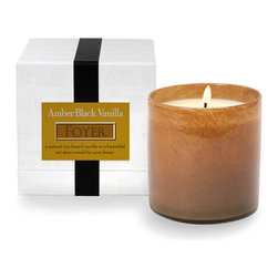 House and Home Amber Black Vanilla / Foyer Candle - Blue twilight arrives, bringing with it a velvet quiet softly illumed with the House and Home Amber Black Vanilla/Foyer Candle. Warm and welcoming, the candle scent is wonderfully light without being overly sweet. A mix of amber, vanilla, and patchouli creates a delightfully familiar fragrance that speaks of the comforts of home.