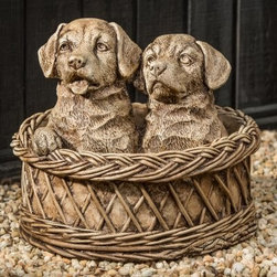 Campania International Basket Cases Garden Statue - Welcome guests to your home or garden with a double dose of cuteness. The Campania International Basket Cases Garden Statue is a basket of two adorable puppies. From adoring gazes to ruffled fur, this statue is highly detailed to bring each puppy's personality to life. It is handmade of weather-resistant cast stone concrete that undergoes a 15-step process create exacting details. This basket full of puppies is available in a variety of finish options and comes unsealed so it will naturally develop an antiqued look over time.About Campania InternationalEstablished in 1984, Campania International's reputation has been built on quality original products and service. Originally selling terra cotta planters, Campania soon began to research and develop the design and manufacture of cast stone garden planters and ornaments. Campania is also an importer and wholesaler of garden products, including polyethylene, terra cotta, glazed pottery, cast iron, and fiberglass planters as well as classic garden structures, fountains, and cast resin statuary.Campania Cast Stone: The ProcessThe creation of Campania's cast stone pieces begins and ends by hand. From the creation of an original design, making of a mold, pouring the cast stone, application of the patina to the final packing of an order, the process is both technical and artistic. As many as 30 pairs of hands are involved in the creation of each Campania piece in a labor intensive 15 step process.The process begins either with the creation of an original copyrighted design by Campania's artisans or an antique original. Antique originals will often require some restoration work, which is also done in-house by expert craftsmen. Campania's mold making department will then begin a multi-step process to create a production mold which will properly replicate the detail and texture of the original piece. Depending on its size and complexity, a mold can take as long as three months to complete. Campania creates in excess of 700 molds per year.After a mold is completed, it is moved to the production area where a team individually hand pours the liquid cast stone mixture into the mold and employs special techniques to remove air bubbles. Campania carefully monitors the PSI of every piece. PSI (pounds per square inch) measures the strength of every piece to ensure durability. The PSI of Campania pieces is currently engineered at approximately 7500 for optimum strength. Each piece is air-dried and then de-molded by hand. After an internal quality check, pieces are sent to a finishing department where seams are ground and any air holes caused by the pouring process are filled and smoothed. Pieces are then placed on a pallet for stocking in the warehouse.All Campania pieces are produced and stocked in natural cast stone. When a customer's order is placed, pieces are pulled and unless a piece is requested in natural cast stone, it is finished in a unique patinas. All patinas are applied by hand in a multi-step process; some patinas require three separate color applications. A finisher's skill in applying the patina and wiping away any excess to highlight detail requires not only technical skill, but also true artistic sensibility. Every Campania piece becomes a unique and original work of garden art as a result.After the patina is dry, the piece is then quality inspected. All pieces of a customer's order are batched and checked for completeness. A two-person packing team will then pack the order by hand into gaylord boxes on pallets. The packing material used is excelsior, a natural wood product that has no chemical additives and may be recycled as display material, repacking customer orders, mulch,or even bedding for animals. This exhaustive process ensures that Campania will remain a popular and beloved choice when it comes to garden decor.Please note this product does not ship to Pennsylvania.