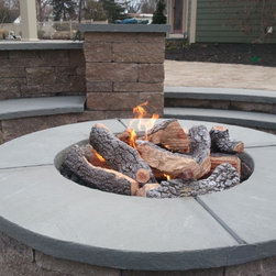 Estate makeover - This recessed fire pit was a huge undertaking.  Complete with seepage pit underneath, wall block by Techo-Bloc, and custom radius cut bluestone by Stoneworx.  Recessing the fire pit created a cozy little nook for the family to spend time connecting in the fall.