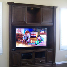 Traditional Home Theater by PACHECO-MARTINEZ & ASSOCIATES LLC.