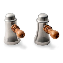 Pewter Finish Salt and Pepper Shakers - Colored with a rich heirloom metallic to convey authenticity and warmth on your table, the Pewter Finish Salt and Pepper Shakers have wood handles that coordinate with farmhouse tables and general good cheer. Between the polished glow of the tapering bodies and the practicality of the design, their impression of welcome and bonhomie is instantaneous.