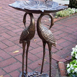 Oakland Living - Two Cranes Holding Lily Pad Bird Bath in Anti - Crane and floral themed. High-grade polyester powder coat finish. Brass and stainless steel hardware ensures sturdiness, durability and security for years. Long lasting, beautiful finish maintains appearance for years to come. Minimal maintenance. Electrostatic application of the powder coat insures a smooth, even finish. Quick and easy assembly assured with step-by-step assembly instructions included. Double QC quality program in which each piece is assembled prior to being unassembled and packaged assures that all parts are present and that the product will assemble easily. Cast iron and cast aluminum construction. Antique Bronze finish. 18.5 in. W x 18.5 in. D x 30 in. H (32 lbs.)