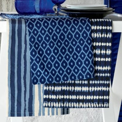 TAG Indigo Dish Towel - Set of 3 - About TagFounded by NYU graduate and current owner Norman Glassberg in 1975, Tag is a leader in textiles, gifts, and furnishings, and manufactures their products in nine different countries. With a huge variety of products available to enhance the beauty and comfort of your home, Tag focuses their attention on the idea of a central look with all of their pieces - you can tell a Tag furnishing by its distinctive, clean-lined style that's unlike anything else. Today, Tag's main goal (aside from maintaining their unique aesthetic) is to bring you high quality, affordable products you'll be proud to use and display.