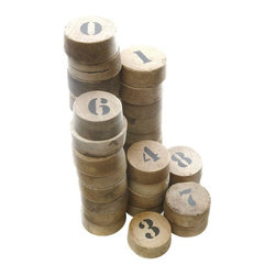 "35 Stenciled Wood Corks - A Set - A fun set of stenciled vintage wood corks. Creates a great graphic when grouped together or separated out by your favorite number. Some surface wear throughout. They have a slight taper to them. The numbered side is approximately 2.25"" across and the underside is slightly over 2"". Dimensions will vary slightly with each one. These would make a fun interactive art installation or an interesting display for a retail environment."