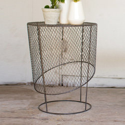Wrap Around Accent Table - Keep your table options all wrapped up, but none too tidy. This open mesh accent table is a cool diversion from traditional offerings. And if you enjoy interior design that's a little bit off center, this one's for you.