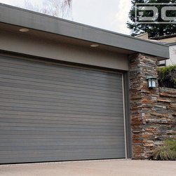 Dynamic Garage Door - Custom Designed Modern Garage Doors by Dynamic Garage Door | Danville CA Project - Contemporary and Modern are design styles that are particularly similar in many ways. Our Contemporary Custom Garage Doors are specifically designed and manufactured to fit the minimalistic lines of modern and contemporary architecture styles. Sometimes the most beautiful things in life come in simplicity and our Contemporary Garage Doors are just proof that simplicity can be elegant, sophisticated and architecturally attractive. Dynamic Garage Door uses uniquely diverse materials to accomplish garage door designs that work with the existing architecture.
