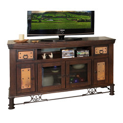 "Valencia 4 Door TV Stand - 63 Inch - Hand-hammered genuine copper panels fired in the old world tradition are the star of the Valencia 4 Door 63 Inch TV Stand. Made from 100% solid pine with a multi-step lacquer finish on a hand forged iron base  this stand features two small dovetail drawers with full extension glides  one DVD/CD tray behind each of the two side doors  one fixed shelf behind the smoked and beveled glass center doors  one 32""W compartments for components  mortise and tenon joints and hand forged hardware. The color of the copper panels varies due to the firing process and is protected by a clear lacquer coating. Measures 63""W x 20""D x 36""H. ~ Ships from the manufacturer. Allow 3 to 4 weeks."