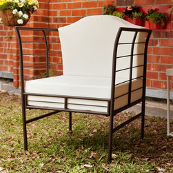 Upton Home - Sheridan Indoor/ Outdoor Chair - This Sheridan indoor/ outdoor chair features a brown metal grid frame with subtle curves and off-white cushions for the seat and back. This chair is a striking and enjoyable addition to the backyard or patio.