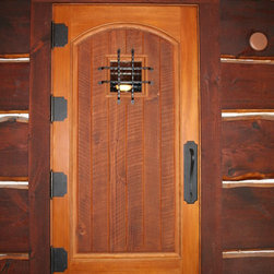 """Entrance Door - Custom 3"""" entry door made of CVG douglas fir with circle sawn panel. includes 7"""" RMH hinges and wrought iron details."""